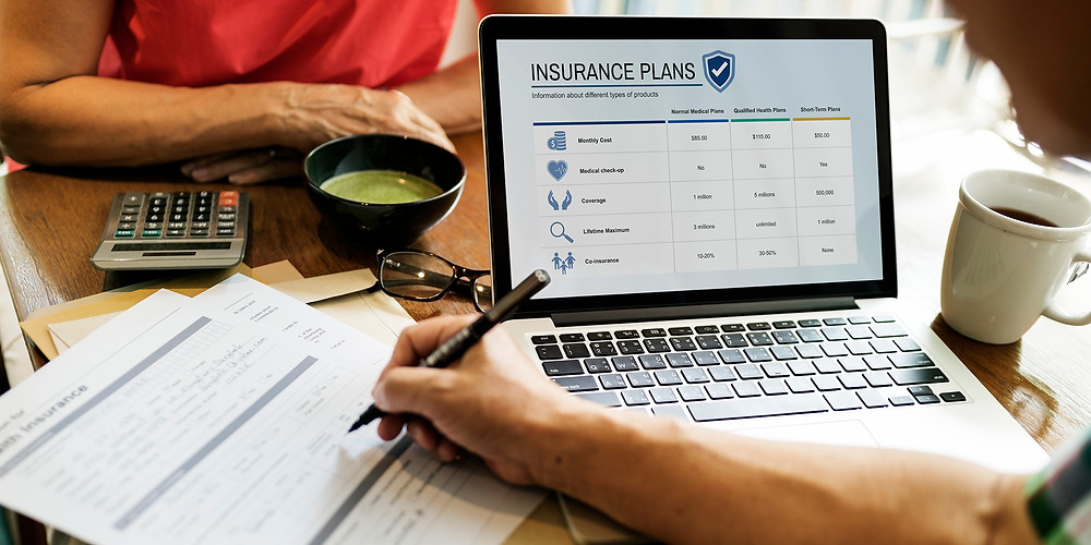couple reviewing medical insurance options