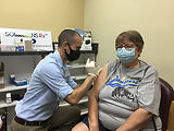 Staff Member Administering Vaccine to Pa