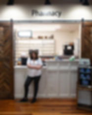 Pharmacist Katie Bell standing in front of Bell's Family Pharmacy counter