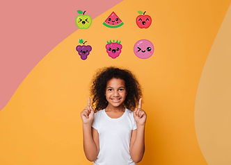young girl smiling pointing to flavor icons