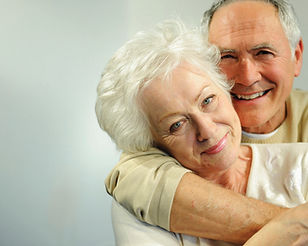 Older couple hugging and smiling