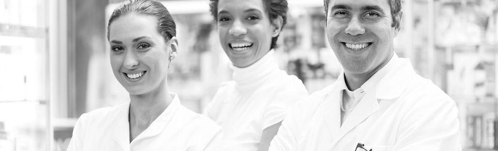 pharmacists smiling at camera
