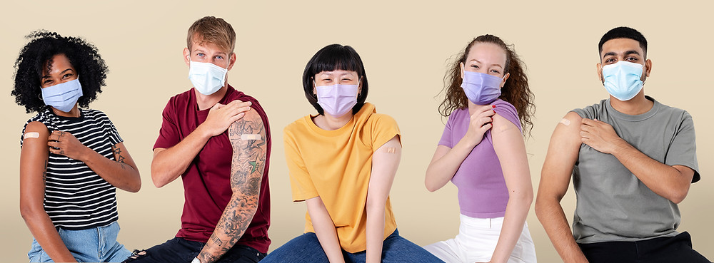 group of vaccinated individuals wearing masks
