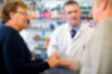 Pharmacist consulting with couple