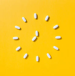 white pills_clock_top view_med sync_yell