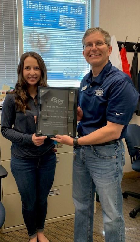 Wayne Myers accepting Flip the Pharmacy award