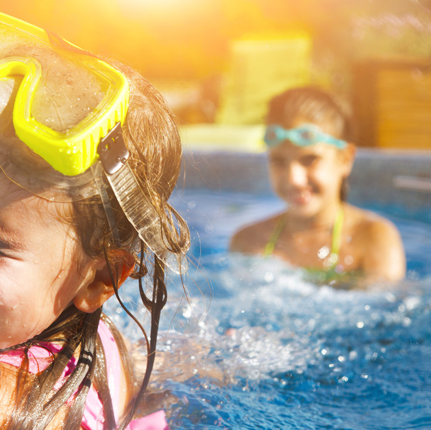 girls playing in swimming pool