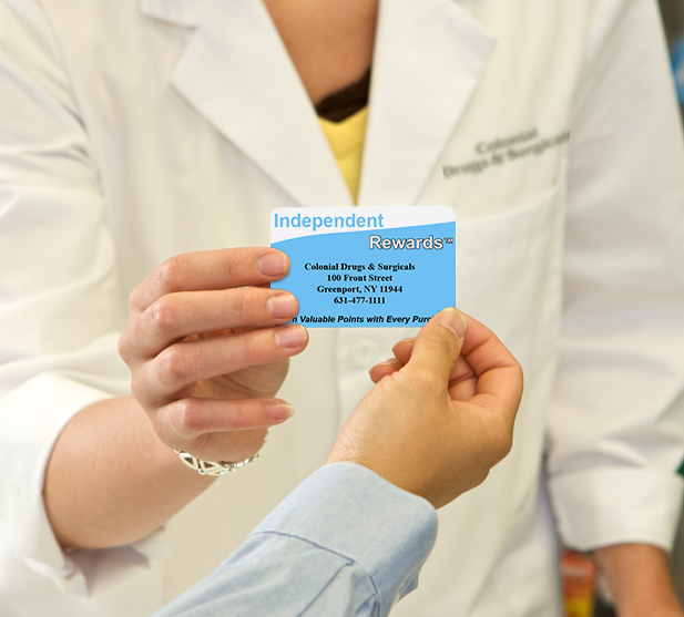 pharmacist handing reward card
