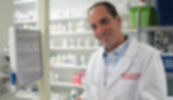 Larry Kaufman, owner of Smith Brother's Pharmacy standing at the counter