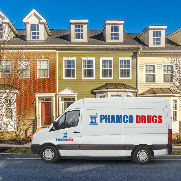 Phamco delivery van in front of townhomes