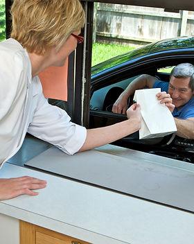 Pharmacist at drive thru window