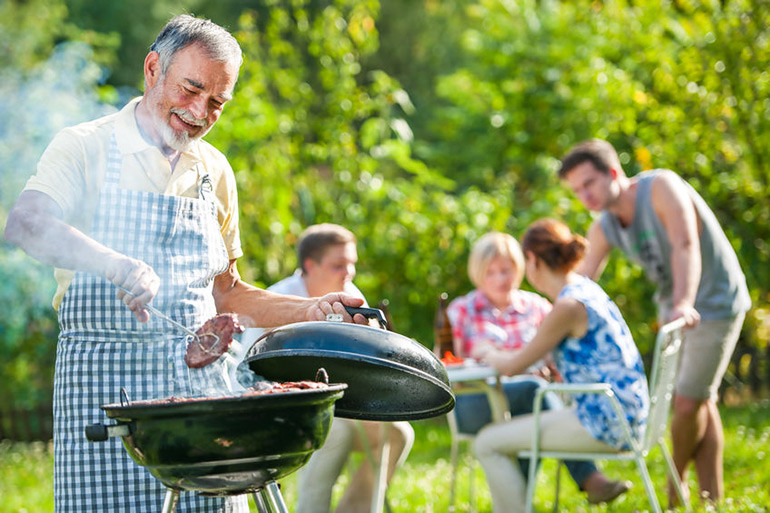 Family barbecuing outside