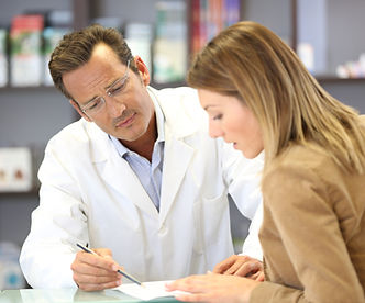 pharmacist talking with female patient