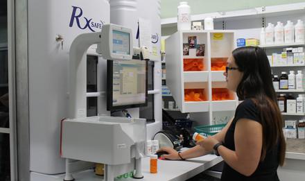 Wolfe's Pharmacy team member entering prescription information into database