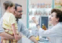 Pharmacist helping child