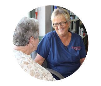 Sissy pharmacy staff member talking and smiling wih customer
