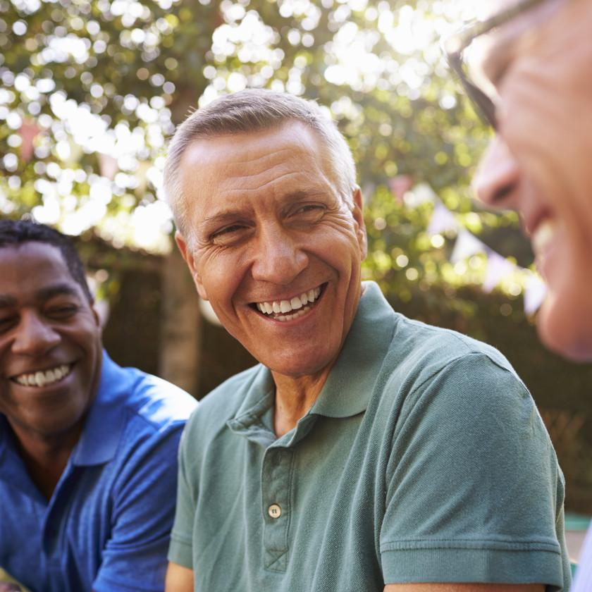 group of three men laughing