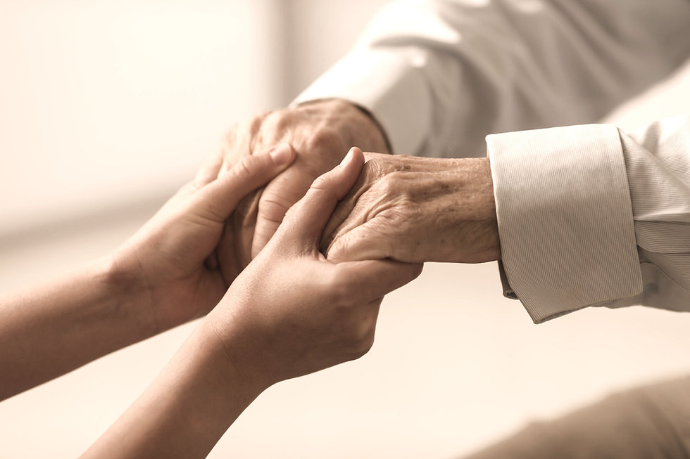 nurse holding senior citizen's hands (closup)
