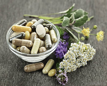 bowl of natual supplements and flowers