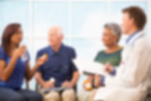 Pharmacist talking to a group of patients