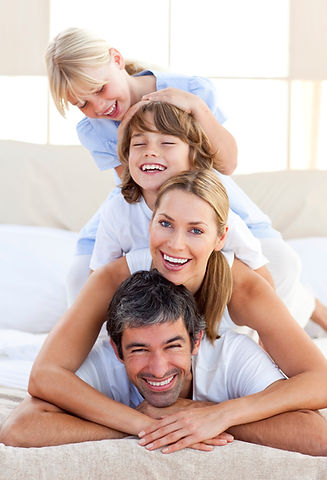 happy family smiling and laughing