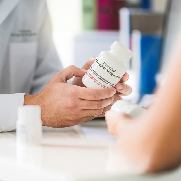 pharmacist explaining medication