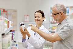 Pharmacist with man in pharmacy.jpg