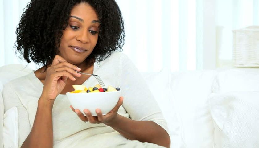 women eating fresh fruit