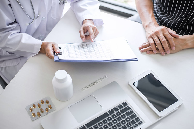 Pharmacist meeting with patient