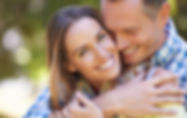happy couple embracing, woman looking at