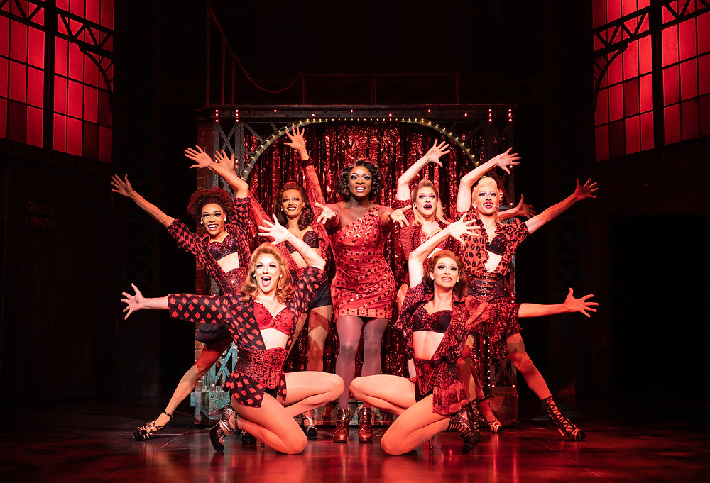 Kayi Ushe as Lola with the Angels in Kinky Boots: Photo Helen Maybanks