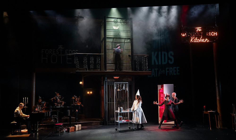 L-R: Conductor Richard Peirson (at piano), Raphaela Mangan (Hansel, above in cage) Carolyn Dobbin (Witch, in white), Amy Ní Fhearraigh (Gretel), and Raymond Keane (The Night Watchman). Image by Patrick Redmond