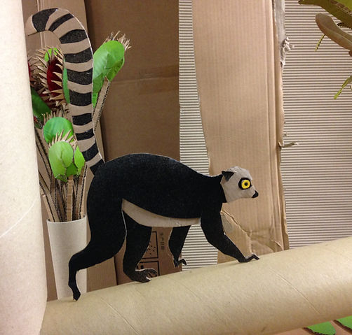 Lottie Smith Cardboard sculpture prop set racoon David Attenborough Biscuithead and the biscuit badgers music video