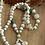 Thumbnail: Sautoir pompon blanc
