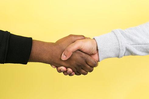 hand-shake-on-yellow_4460x4460.jpg