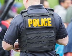 Police uniform on the back of policeman.