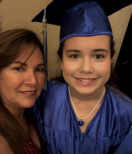 Teacher and Graduating Student