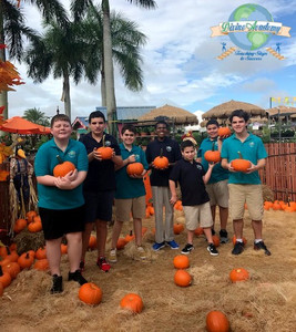 Divine Academy students picking pumpkins at the Flamingo Road Nursery in Davie, FL.