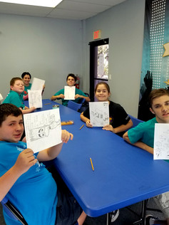 Students Showing Their Drawings