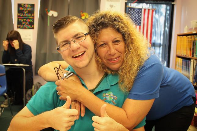 Teacher Hugging Student