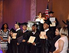 Divine Academy graduating class receiving their diplomas