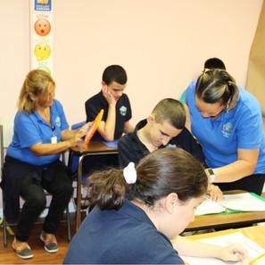 Teachers Helping Students