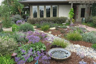 Decorative landscape with Dry Creek and Bird Bath