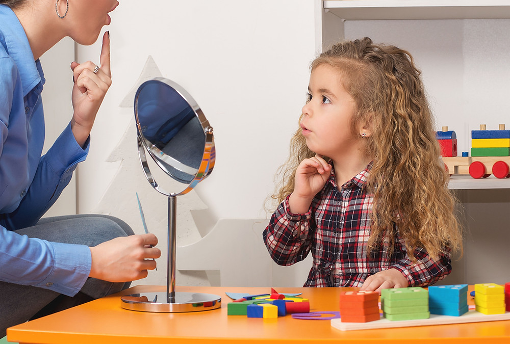 Child in a speech therapy session - articulation therapy