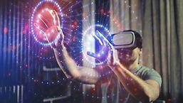 Man using VR headset touching air-1600x9
