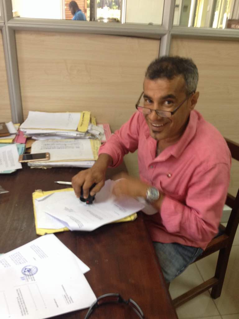 Hifadhi's chairman Nassor El-Mahruki signing the paperwork