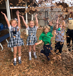 EDS Students play in Leaves