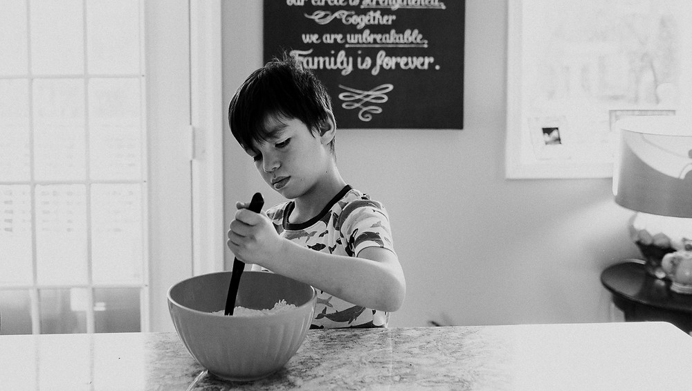 Boy helping with pancakes family photography Whitby