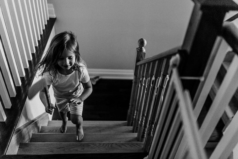 Running up the stairs Whitby family photography