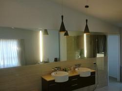 Illuminated vanity mirror wall